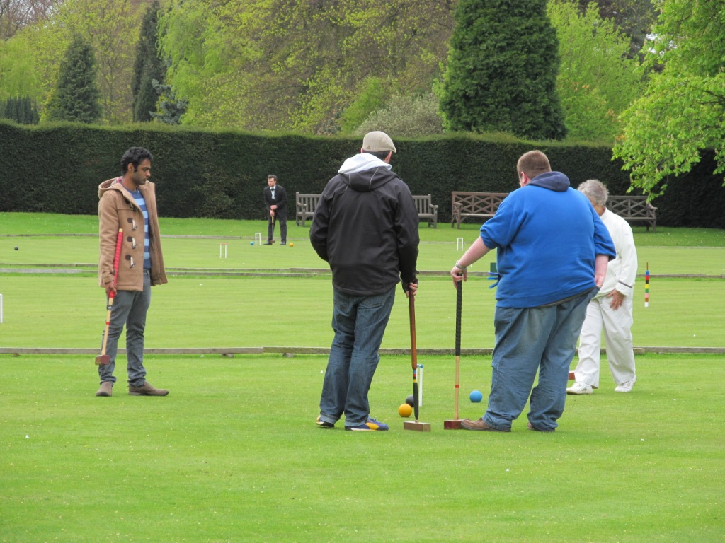 Club members and students in play on the Bowling Greens